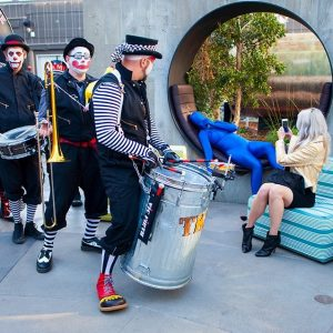 A trash can marching band + performance artists will add unique flavor to your special event.